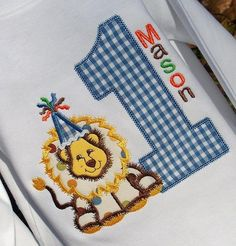 Little eyes will grow as big as this lion number birthday shirt or onesie.  Appliqued lion with age done in blue gingham makes this an adorable shirt for his birthday safari party theme.  Comes personalized with your little boys name.