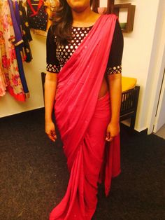 Contrast your red saree with black mirror-work blouse