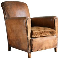 View this item and discover similar for sale at - A French leather club chair, with brass studding and velvet cushion. Circa Available to view at Brunswick House, London. Small Living Room Chairs, Herman Miller Aeron Chair, Leather Club Chairs, Victorian Interiors, Velvet Cushions, Leather Furniture, Dining Table Chairs, Home Decor Furniture, Farmhouse Table