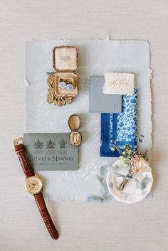 groom accessories styled on a flatlay; gieves and hawkes leather strap brown and gold watch; vintage ring box and bulgari groom gold matte wedding ring; pale blue cuff links; leather wallet; calligraphy white font on pale blue handmade paper | Photo by London and Newcastle UK based light bright and airy Filipina wedding photographer Cristina Ilao Autumn Wedding, Chic Wedding, Spring Wedding, Wedding Blog, Wedding Shoes, Stationery Items, Wedding Stationery, Hedsor House, Vintage Ring Box