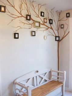 """Paint a tree on your wall and hang your frames on it! Gives a whole new meaning to """"Family Tree""""! #diy #decor"""