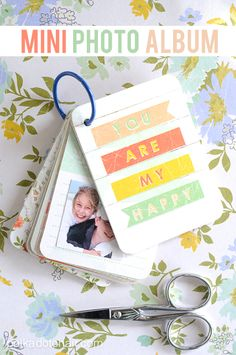 Adorable DIY Mini Scrapbook Album. This would be an awesome brag book gift for grandparents.