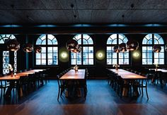 Dining tables were made longer to fit the large dining space - Image - Union Restaurant Basel