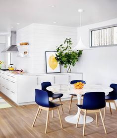 Remodel by Matt Garcia Design. Crisp, clean white plus THOSE blue chairs