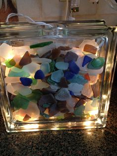 Sea glass lamp by Laurie Riviello- idea from book on sea glass crafts. #GlassLamp #seaglasscrafts