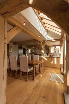 Lovely open plan dining and kitchen area in this new oak frame house in Cornwall. By Roderick James Architects