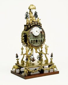This musical clock by William Carpenter is typical of the kind of elaborate exotic time-piece made in London for export to the East in the late 18th century. Turkey, China and India were the principal destinations for these clocks. Ownership & Use The measurement of time was only one small feature of these clocks. This clock offered a choice of six tunes - two dances, two jigs, a song and a march. The figures dressed in 18th-century costume mounted on the clock, hold bells. The standing…