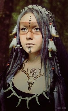 Female shaman. Her facial makeup is my personal favorite out of all the pictures I've gathered.