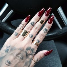 Simple, Blood-red nail effect for Vampires ~ https://www.pinterest.com/FXContactLenses/vampire-makeup-fx-contacts/