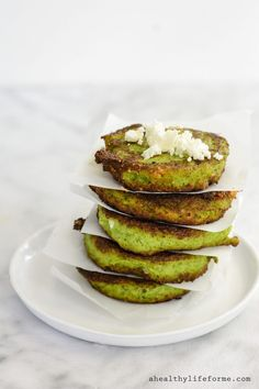 Broccoli Feta Fritters are the perfect way to enjoy your Broccoli.  Feta makes these green little discs a little salty and creamy and a quick fry gives them a nice crunchy edge. | ahealthylifeforme.com