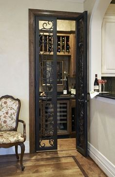 Convert closet off the kitchen to a wine room. Love these doors!