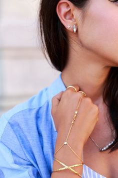 Gorjana Elea cuff in gold and Bali hand chain thanks to Nordstrom