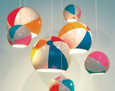 Lamp shades created with actual recycled beach balls.. made by rigidifying the inside with resin so a hole can be cut, then the insides are sprayed white. Designed by TOBYhouse