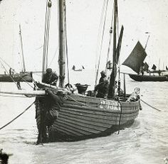 H01270 Launching a fishing boat at Hastings (East Sussex Libraries Historical Photos) Tags: sea beach boat costume fisherman library sails mast hastings fishingboat lugger magiclanternslide 233rx
