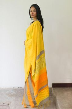 This bright yellow saree has a complex yet a light jacket. This 100% cotton saree is soft and can be draped easily.