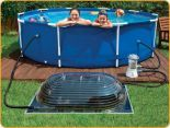 Want to know all the ins and outs of how a solar pool heater works? Discover the best products to use and how to get the most out of solar energy. Homemade Swimming Pools, Natural Swimming Pools, Swimming Pools Backyard, Diy Pool Heater, Solar Heater, Homemade Pool Heater, Oberirdische Pools, Greenhouses For Sale, Best Solar Panels
