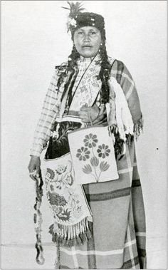 An unidentified woman of the Ojibwa Nation with Bandolier Bags. No date or additional information.