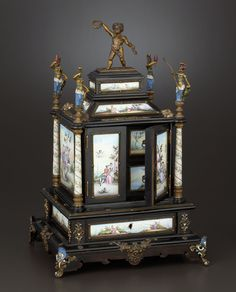A VIENNESE ENAMEL ON COPPER, GILT BRONZE AND WOOD TABLE CABINET Vienna, Austria, circa 1875