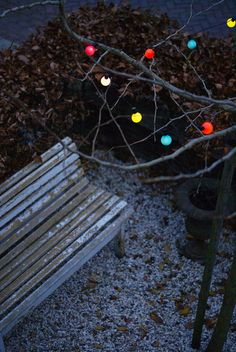 colored lights in the tree by wood & wool stool