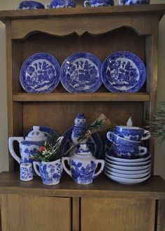 Child's hutch displaying Blue Willow china.