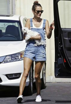 Alessandra Ambrosio wearing Superga Classic Sneakers in White, Westward Leaning N.1.1 Children of California Sunglasses and Black Orchid Overall Shorts in Solitaire.
