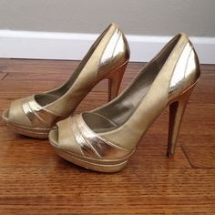 Bakers gold heels Stunning bakers heels. Great for a fancy night out!! Do have some signs of wear, but still have a lot of life left! Had anti slip grips on the bottom to help prevent any slip and falls! Bakers Shoes Heels