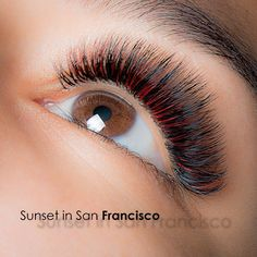 Beautiful red and black eyelash extensions by Eva Bond studios