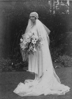ca 1926 photo of the original owner wearing the previously posted 1926 English silk/lace/rhinestone/pearls/beads wedding dress. Thats quite a veil!