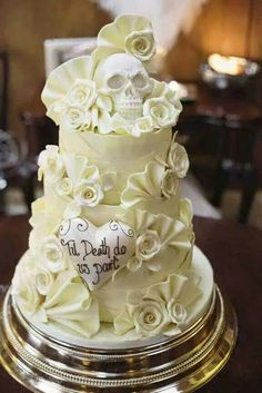 Till death do us part wedding cake with roses and skulls and hearts