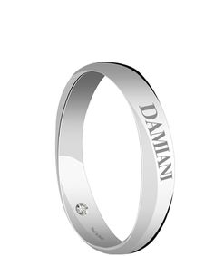 Damiani white gold band with a secret diamond
