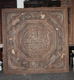 An intricately hand carved ceiling panel form a Chinese home is made from camphor wood. This architectural element is patterned with auspicious images to please the eye and communicate wishes and desires to the gods.