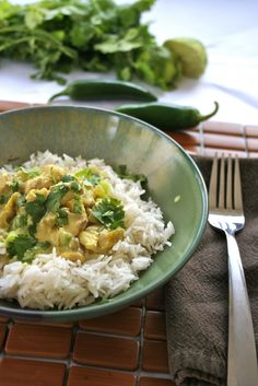 1 lb boneless, skinless chicken breasts, cut into 1-inch cubes  3 cloves garlic, minced  1-2 tsp curry powder  1 14 oz can light or regular coconut milk  1 4 oz. can diced green chiles  Zest and juice of 1 lime  1/4 cup green onion, chopped  2 tbsp fresh cilantro, chopped (optional)