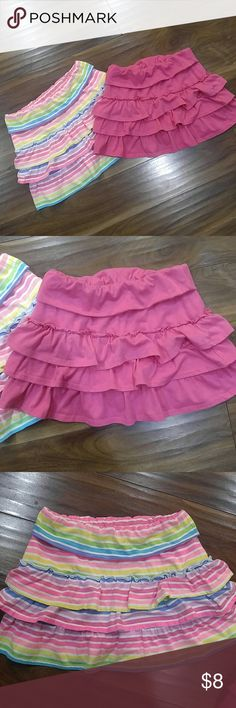2 ruffled skirt/short bundle Neon rainbow stripes and magenta solid, 3 tiered ruffle skirt/short combo. Good condition, worn but no flaws. Size 8 Bottoms Skirts