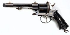 Colard Belgian Double Action Pinfire Revolver - 12 mm pinfire, ca. 1870-1880.   Elegant decoration includes flush gold and silver inlay, sculpted sights, and carved ebony grips. And why this revolver didn't have a starring role in a Robert Downey Jr. Sherlock Holmes movie or The League of Extraordinary Gentlemen is beyond me.