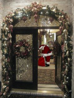 Santa caught in the doorway  - You can add Santa - Holiday Quotes & More to Your Photos right from your Phone. Check it out just CLICK> Capturethemagic.com