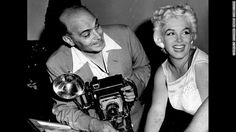 Mike Rotunno was a newspaper photographer who started a business at Midway Airport in 1930s Chicago, shooting pictures for travelers who wanted a memento as they passed through. Many celebrities were among them. Here, Rotunno poses with Marilyn Monroe in 1955.