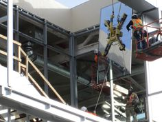 A Glazier installing glass at the Nu Skin Pavilion in Provo, Utah