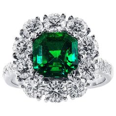 2.16 Carat Colombian Emerald and Diamond Cluster Ring | From a unique collection of vintage fashion rings at https://www.1stdibs.com/jewelry/rings/fashion-rings/