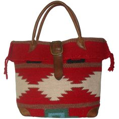 A bold ethnic-inspired print highlights this 'Roamer' tote bag fromAmerileather. Constructed of a durable wool-blend, this handbag isfinished with dark brown leather handles, a belt strap buckleclosur