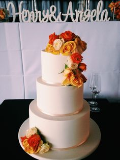 Angela And Henrys Three Tier Wedding Cake Finished With Cascading Fresh Flowers Made By