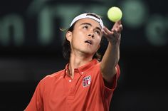Taro Daniel Photos Photos - Taro Daniel of Japan serves against Richard Gasquet of France during the Davis Cup by BNP Paribas first round singles match between Japan and France at Ariake Colosseum on February 3, 2017 in Tokyo, Japan. - Japan v France - Davis Cup by BNP Paribas First Round - Day 1