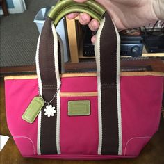 "*Special item!* Authentic Coach mini tote! Adorable mini tote from Coach in a beautiful bright pink! Zipper top closure and a zipper pocket inside, this is in great shape and ready for a new home! Approximate dimensions are 10.5"" L x 5.5"" H.  Bundle up and save! ❗️ All items from a smoke-free home.  More pictures available upon request!   Check out my home made jewelry as well! Thanks for looking! ✨ Coach Bags Totes"