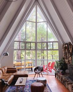 You have unobstructed views of huge floor-to-ceiling windows that look out onto the trees, perfectly framed by the angles of the roof. A Frame Cabin, A Frame House, Cabana, Cabin Design, House Design, Another A, Cabin Interiors, Floor To Ceiling Windows, Nice