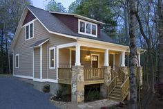 Love the craftsman/cottage style.  Great combo of siding textures.