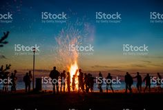 People resting near big bonfire outdoor royalty-free stock photo