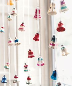 """""""Ornaments as Window Hanging: Maintain a cheerful outlook with the help of a """"curtain"""" fashioned from retro bell-shaped ornaments. Cut a length of ribbon one foot longer than the length of the window. Securely tie the ribbon to a tension rod fitted in the frame. String the bells through the ribbon, knotting them in place about five inches apart. Repeat this across the width of the window, staggering the ornaments."""""""