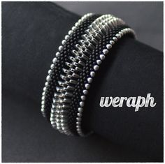 Weraph's crochet bracelet with triangle center - two flat ropes connected by another row of triangles (if I've read this correctly)  Any one else done this one?  #Seed #Bead #Tutorials