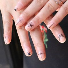Minimal nail art that can be done DIY with a tiny nail brush. #nailart Loving the negative space.