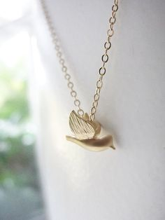 Tiny gold bird necklace 2 - little bird charm on gold filled necklace.