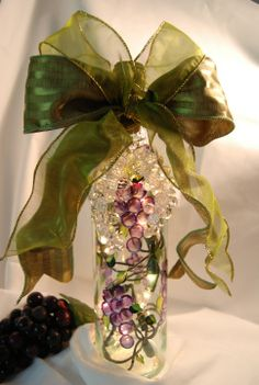 Hand-painted Wine Bottle Lamp: This Wine Bottle Lamp has hand-painted grape designs going all around the wine bottle. This bottle has 20 miniature lights inside. Wine lovers everywhere will love this unique bottle. These are beautiful on display in your kitchen, as a night light in a guest bath or bar or foyer. This makes a great conversation piece and gift.